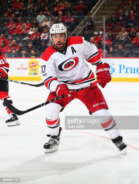 Justin Faulk of the Carolina Hurricanes skates against the New Jersey Devils during the game at Prudential Center on March 25 2017 in Newark New...