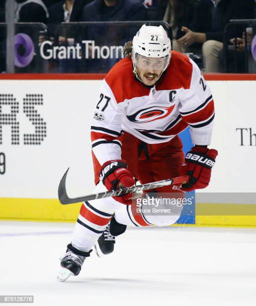 Justin Faulk of the Carolina Hurricanes skates against the New York Islanders at the Barclays Center on November 16 2017 in the Brooklyn borough of...