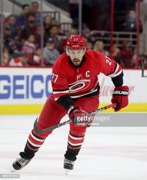 Justin Faulk of the Carolina Hurricanes skates for position on the ice during an NHL game against the Washington Capitals on January 12 2018 at PNC...