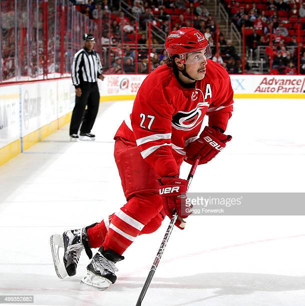 Justin Faulk of the Carolina Hurricanes skates with the puck during a NHL game against the Edmonton Oilers at PNC Arena on November 25 2015 in...