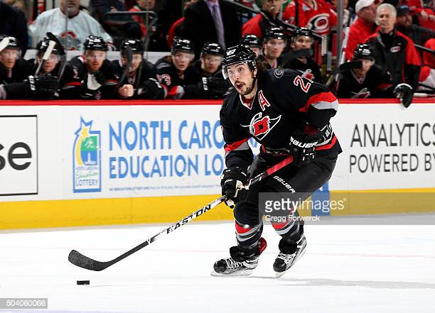 Justin Faulk of the Carolina Hurricanes skates with the puck during an NHL game against the Columbus Blue Jackets at PNC Arena on January 8 2016 in...