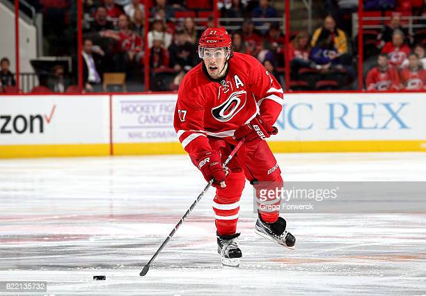 Justin Faulk of the Carolina Hurricanes skates with the puck during an NHL game against the New Jersey Devils on November 6 2016 at PNC Arena in...