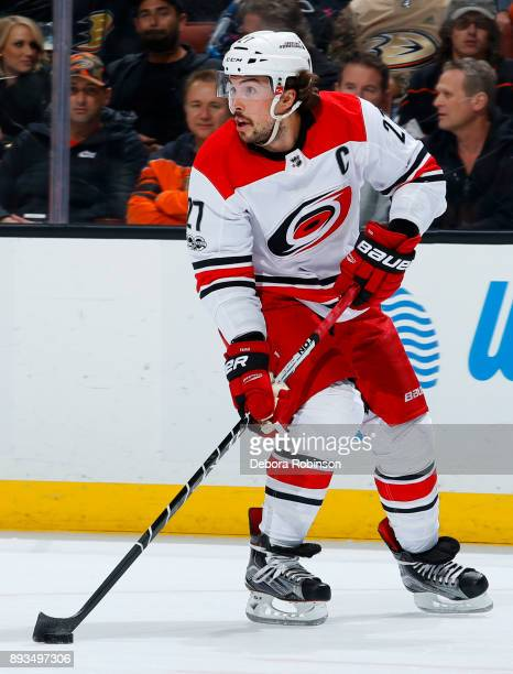 Justin Faulk of the Carolina Hurricanes skates with the puck during the game against the Anaheim Ducks on December 11 2017 at Honda Center in Anaheim...
