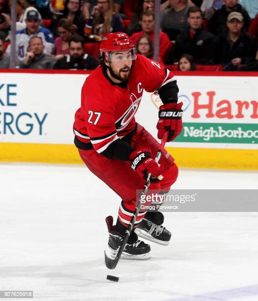 Justin Faulk of the Carolina Hurricanes skates with the puck during an NHL game against the New York Islanders on February 16 2018 at PNC Arena in...