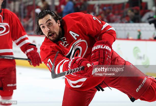 Justin Faulk of the Carolina Hurricanes warms up during pregame prior to an NHL game against the Montreal Canadiens at PNC Arena on April 7 2016 in...