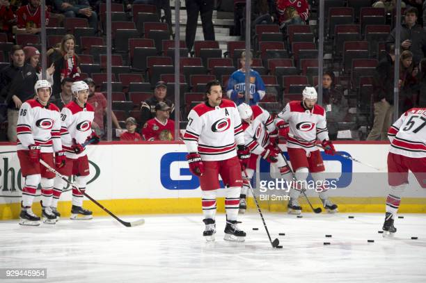 Justin Faulk of the Carolina Hurricanes warms up prior to the game against the Chicago Blackhawks at the United Center on March 8 2018 in Chicago...