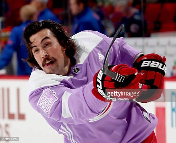 Justin Faulk of the Carolina Hurricanes wears the Hockey Fights Cancer jersey during warmups prior to an NHL game against the New York Islanders on...