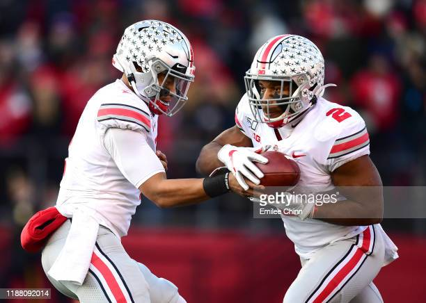 Justin Fields hands off the ball to JK Dobbins of the Ohio State Buckeyes during the first half of their game against the Ohio State Buckeyes at SHI...
