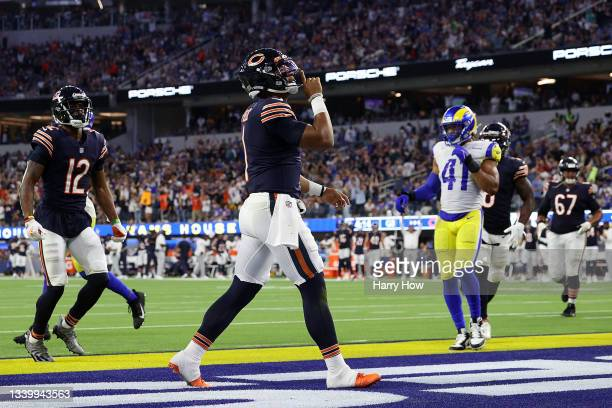 Justin Fields of the Chicago Bears celebrates a touchdown during the second half against the Los Angeles Rams at SoFi Stadium on September 12, 2021...