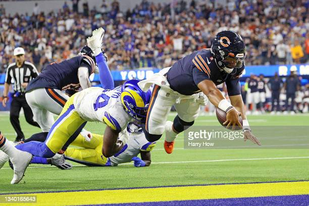 Justin Fields of the Chicago Bears dives for a touchdown during the second half against the Los Angeles Rams at SoFi Stadium on September 12, 2021 in...