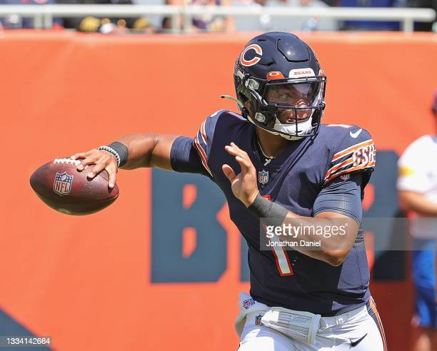 Justin Fields of the Chicago Bears passes against the Miami Dolphins during a preseason game at Soldier Field on August 14, 2021 in Chicago, Illinois.