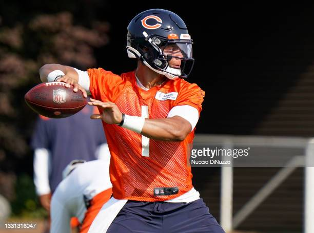 Justin Fields of the Chicago Bears throws a pass during training camp at Halas Hall on July 29, 2021 in Lake Forest, Illinois.