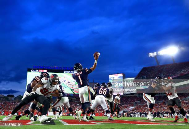 Justin Fields of the Chicago Bears throws a pass in the fourth quarter against the Tampa Bay Buccaneers in the game at Raymond James Stadium on...