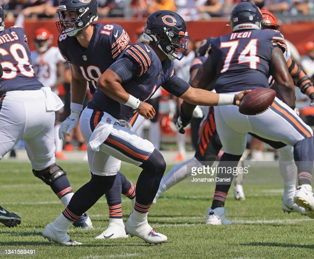 Justin Fields of the Chicago Bears turns to hand off against the Cincinnati Bengals at Soldier Field on September 19, 2021 in Chicago, Illinois. The...