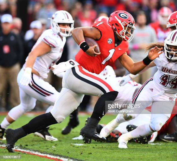 Justin Fields of the Georgia Bulldogs carries the ball during the first quarter against the Massachusetts Minutemen on November 17 2018 at Sanford...