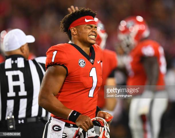 Justin Fields of the Georgia Bulldogs heads off the field after being sacked against the Vanderbilt Commodores on October 6 2018 at Sanford Stadium...