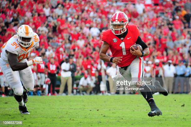 Justin Fields of the Georgia Bulldogs runs the ball against the Tennessee Volunteers on September 29 2018 at Sanford Stadium in Athens Georgia