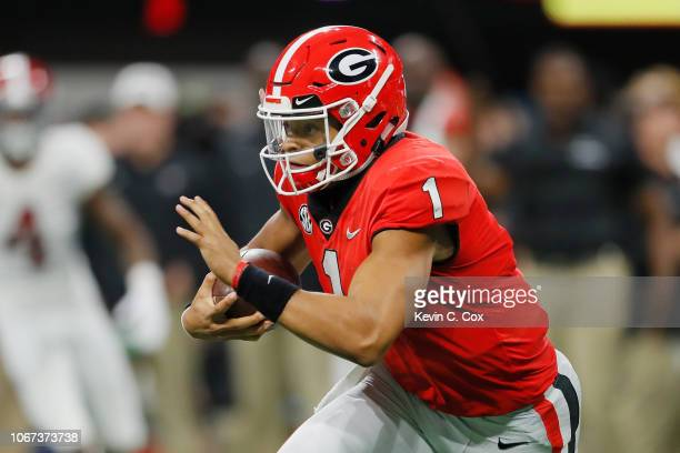 Justin Fields of the Georgia Bulldogs runs with the ball in the first half against the Alabama Crimson Tide during the 2018 SEC Championship Game at...