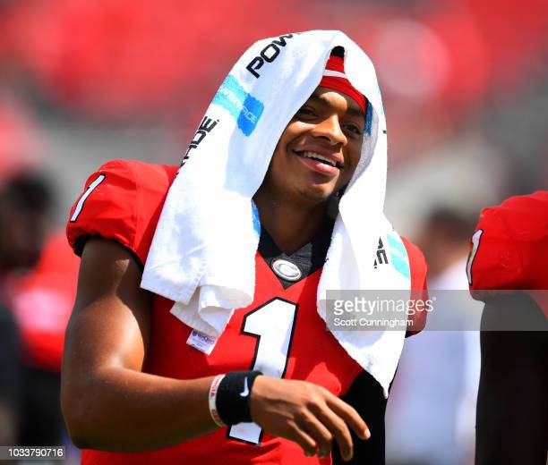 Justin Fields of the Georgia Bulldogs smiles as he leaves the field after the game against the Middle Tennessee Blue Raiders on September 15 2018 at...