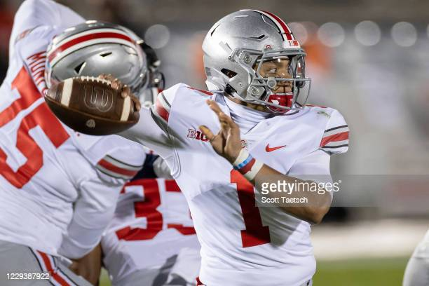 Justin Fields of the Ohio State Buckeyes attempts a pass against the Penn State Nittany Lions during the first half at Beaver Stadium on October 31,...