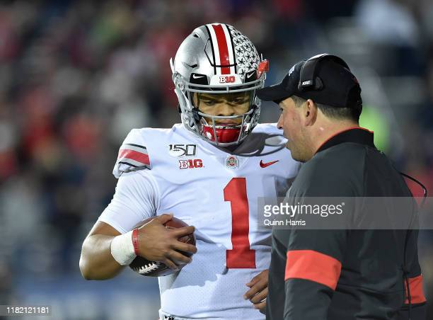 Justin Fields of the Ohio State Buckeyes discusses with head coach Ryan Day of the Ohio State Buckeyes against the Northwestern Wildcats at Ryan...