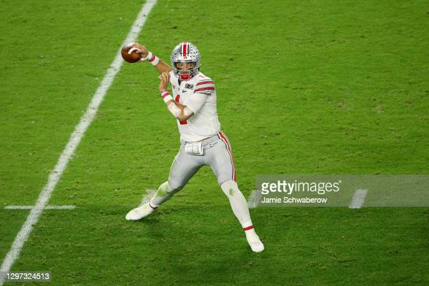 Justin Fields of the Ohio State Buckeyes drops back to pass against the Alabama Crimson Tide during the College Football Playoff National...