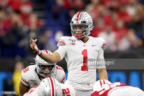 Justin Fields of the Ohio State Buckeyes in action in the Big Ten Championship game against the Wisconsin Badgers at Lucas Oil Stadium on December 07...