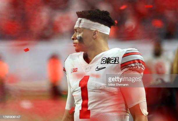 Justin Fields of the Ohio State Buckeyes leaves the field following the College Football Playoff National Championship game against the Alabama...