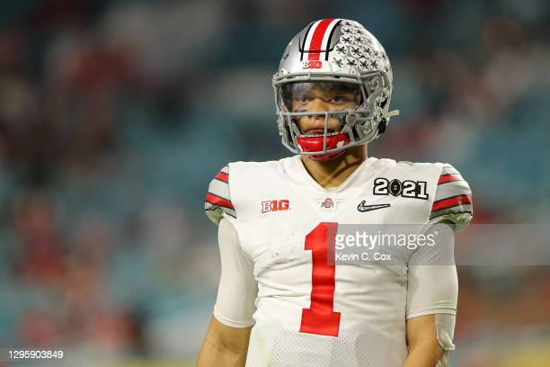 Justin Fields of the Ohio State Buckeyes looks on after a fourth down turnover during the fourth quarter of the College Football Playoff National...