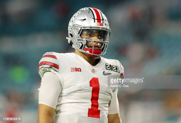 Justin Fields of the Ohio State Buckeyes looks on during the fourth quarter of the College Football Playoff National Championship game against the...