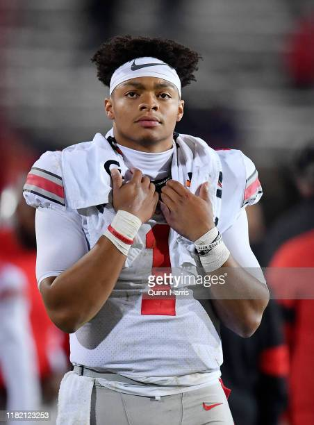 Justin Fields of the Ohio State Buckeyes looks on from the sideline in the fourth quarter against the Northwestern Wildcats at Ryan Field on October...