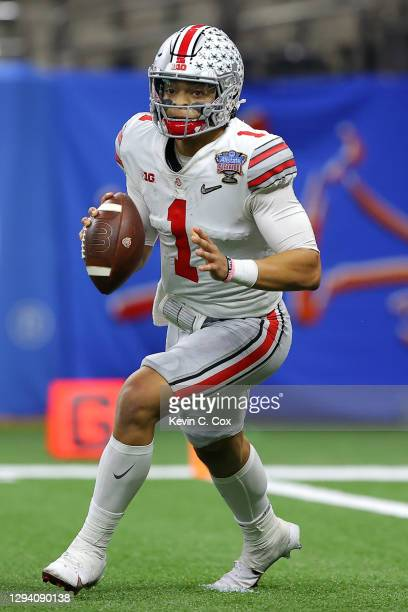 Justin Fields of the Ohio State Buckeyes looks to pass against the Clemson Tigers in the third quarter during the College Football Playoff semifinal...