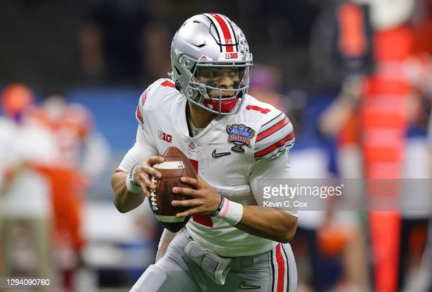 Justin Fields of the Ohio State Buckeyes looks to pass against the Clemson Tigers in the first half during the College Football Playoff semifinal...