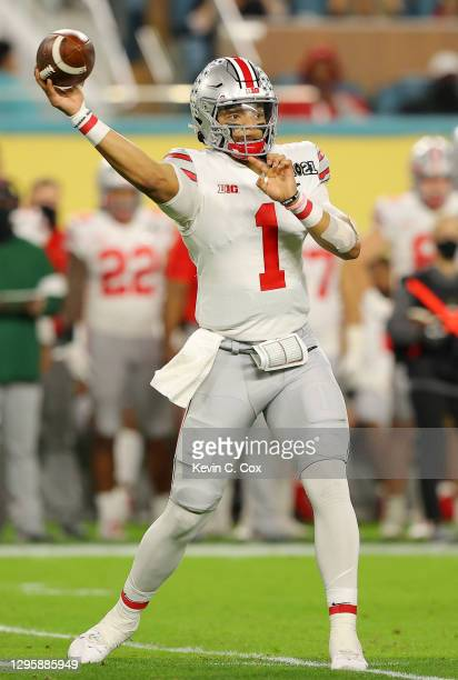 Justin Fields of the Ohio State Buckeyes looks to pass during the first quarter of the College Football Playoff National Championship game against...