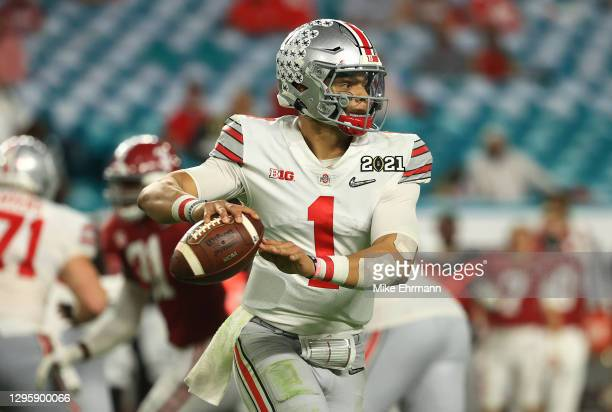 Justin Fields of the Ohio State Buckeyes looks to pass during the third quarter of the College Football Playoff National Championship game against...