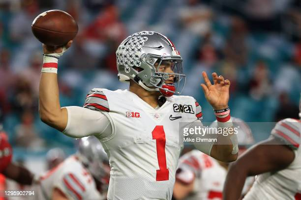 Justin Fields of the Ohio State Buckeyes looks to pass during the fourth quarter of the College Football Playoff National Championship game against...
