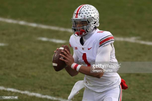 Justin Fields of the Ohio State Buckeyes looks to pass in the second half against the Michigan State Spartans at Spartan Stadium on December 05, 2020...