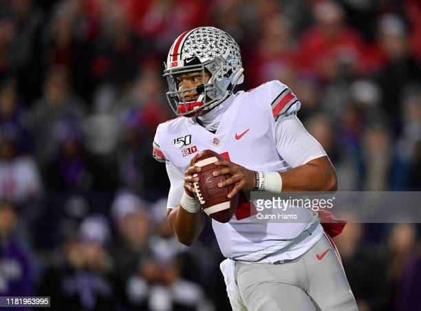 Justin Fields of the Ohio State Buckeyes looks to pass the football in the first quarter against the Northwestern Wildcats at Ryan Field on October...