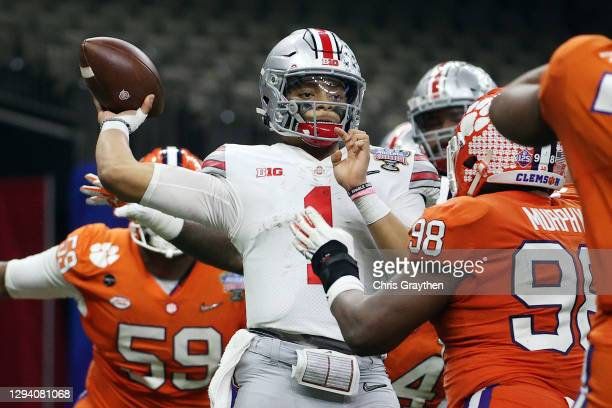 Justin Fields of the Ohio State Buckeyes passes against the Clemson Tigers in the third quarter during the College Football Playoff semifinal game at...