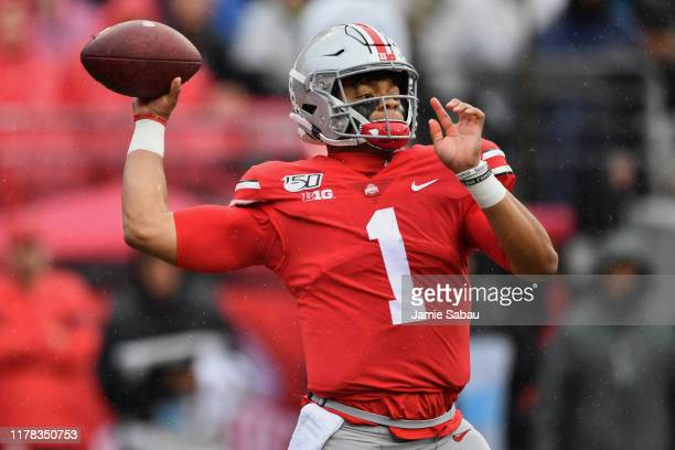 Justin Fields of the Ohio State Buckeyes passes in the first quarter against the Wisconsin Badgers at Ohio Stadium on October 26 2019 in Columbus Ohio