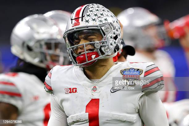 Justin Fields of the Ohio State Buckeyes reacts after a hit against the Clemson Tigers in the first half during the College Football Playoff...
