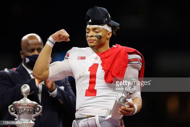 Justin Fields of the Ohio State Buckeyes reacts after defeating the Clemson Tigers 49-28 during the College Football Playoff semifinal game at the...