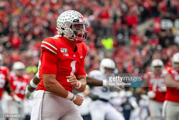 Justin Fields of the Ohio State Buckeyes reacts after running the ball for a first down during game action between the Ohio State Buckeyes and the...