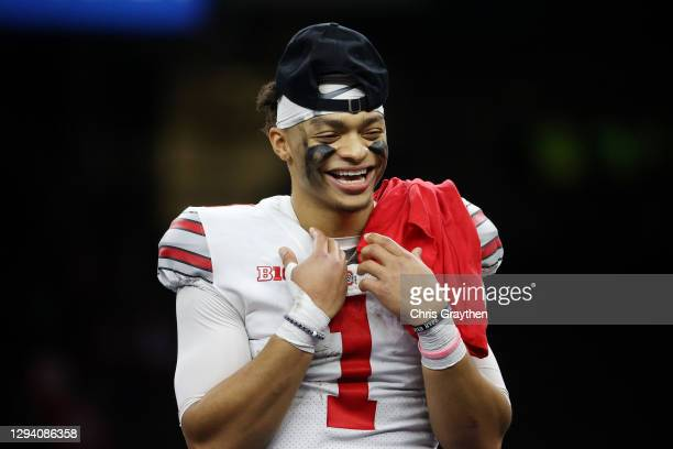 Justin Fields of the Ohio State Buckeyes reacts after the game against the Clemson Tigers during the College Football Playoff semifinal game at the...