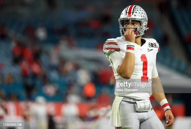 Justin Fields of the Ohio State Buckeyes reacts against the Alabama Crimson Tide during the second quarter of the College Football Playoff National...