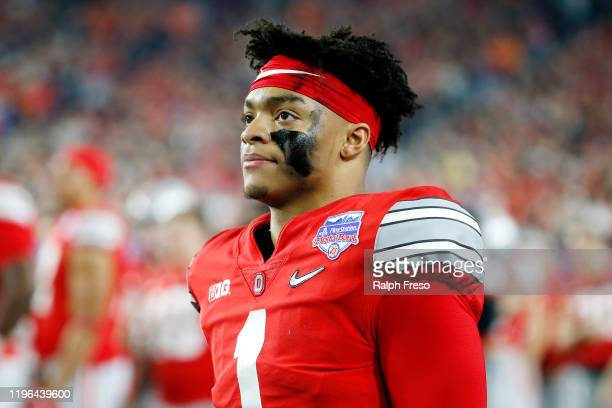 Justin Fields of the Ohio State Buckeyes reacts against the Clemson Tigers in the second half during the College Football Playoff Semifinal at the...