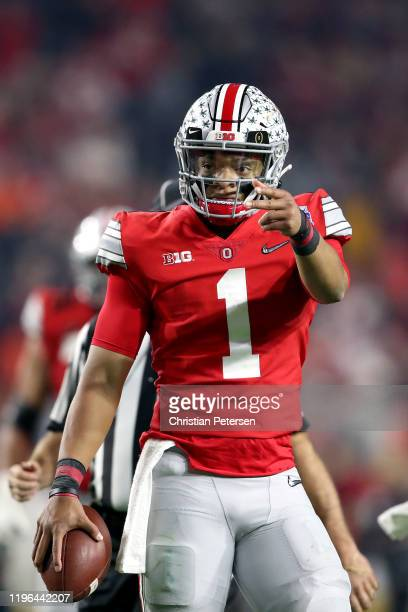 Justin Fields of the Ohio State Buckeyes reacts against the Clemson Tigers in the first half during the College Football Playoff Semifinal at the...