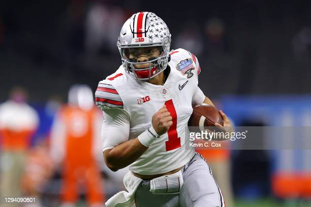 Justin Fields of the Ohio State Buckeyes runs with the ball in the first half against the Clemson Tigers during the College Football Playoff...