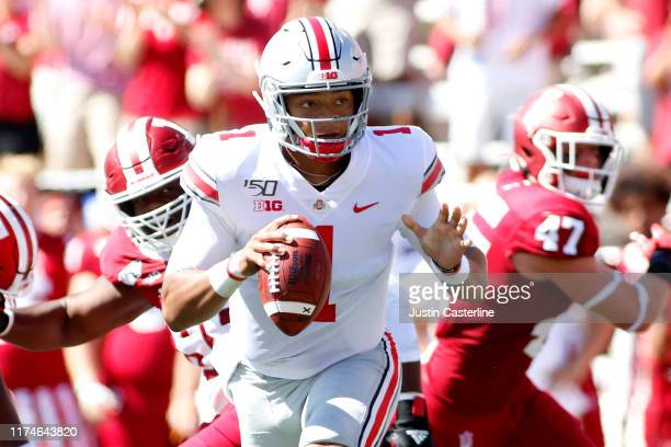 Justin Fields of the Ohio State Buckeyes scrambles in the game against the Indiana Hoosiers at Memorial Stadium on September 14 2019 in Bloomington...