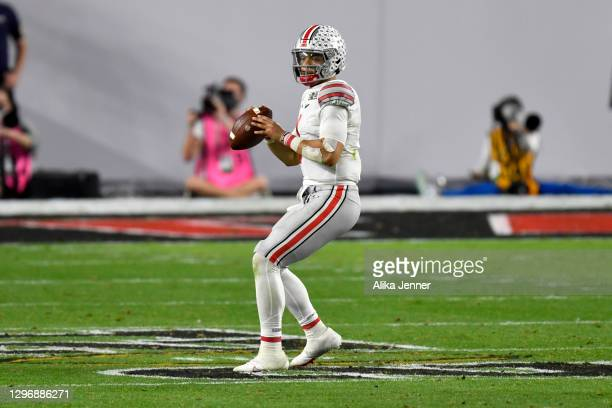 Justin Fields of the Ohio State Buckeyes stands in the pocket during the College Football Playoff National Championship football game against the...